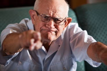 Senior man pointing